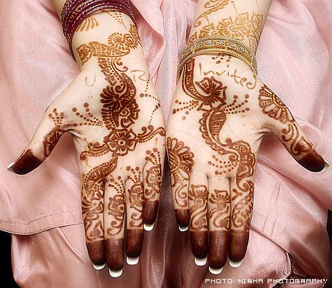 http://www.culturalwedding.com/gvrd/data/media/37/mehndi_invitation.jpg